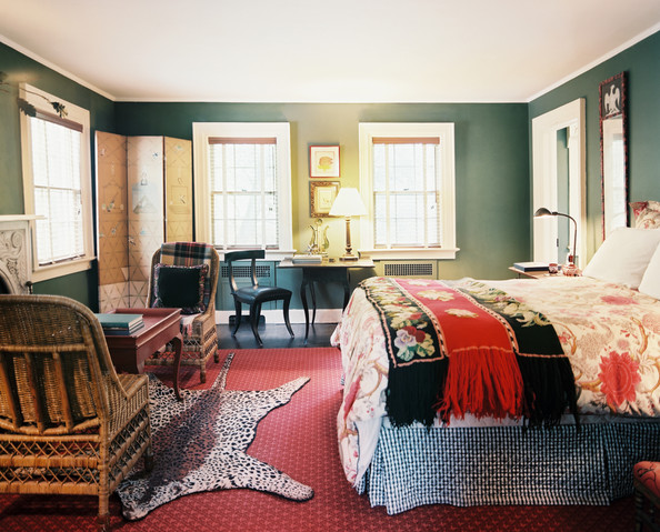 Red Bedroom - A mix of patterns in a green-walled bedroom