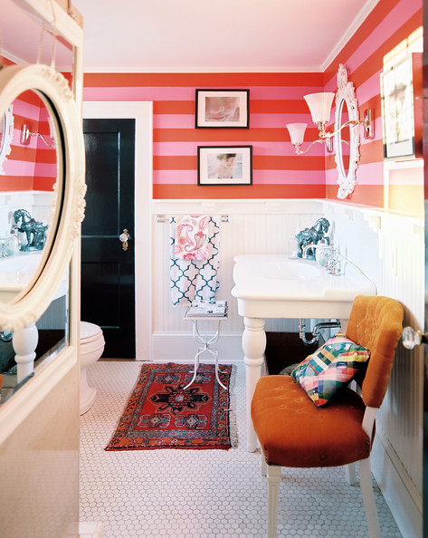 Red - Pink-and-red stripes and white paneling and tile in a cheerful bathroom