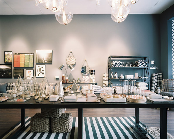 Retail Store Design Ideas dwell studio nyc store dark gray built in shelving surrounds a seating area Retail Store Design Rustic An Array Of Haus Interior Merchandise