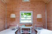 A small wood barn serves as a handsome bedroom