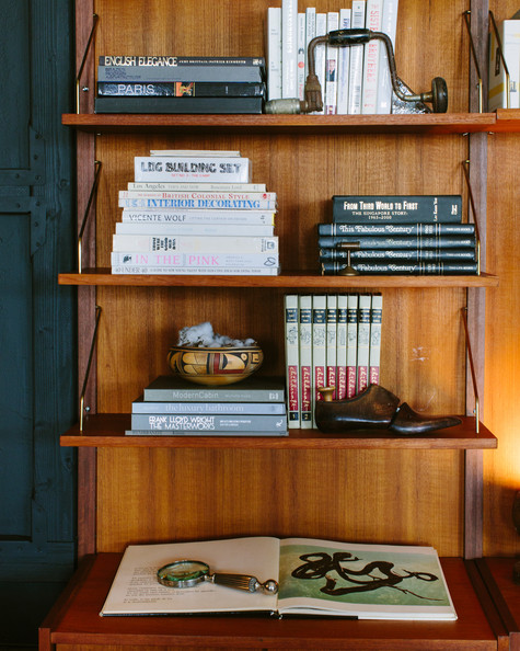 Rustic Bookshelf - Wooden shelves with an esoteric collection of design books