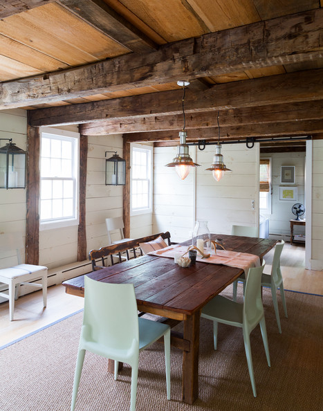 rustic dining room features exposed beams and pendant lights