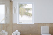 A spacious bathroom with views of the ocean