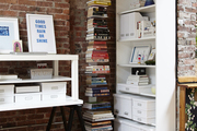This is an organized corner featuring a stacked bookcase.