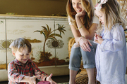 Chloe Warner with her two children in their living room