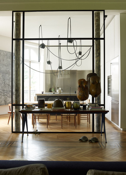 Specialty Room - A kitchen with a contemporary light fixture, African art, and a clear glass divider to the living room