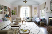 A barrel-vaulted living room, full of textiles, artworks, and vintage finds