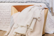 A detail of blankets in a bag.