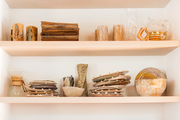A detail of neutral shelves in a kitchen.