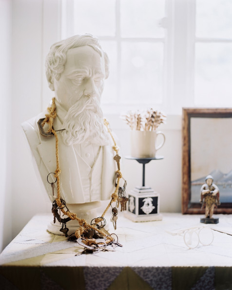 Tablescape - A bust decorated with a necklace of keys