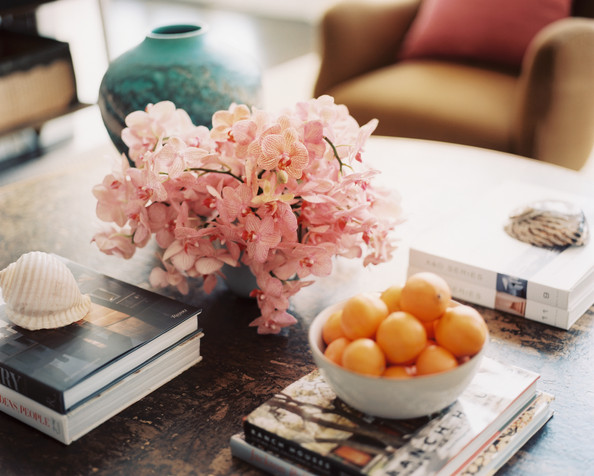 Tablescape - A rustic coffee table decorated with books and natural objects