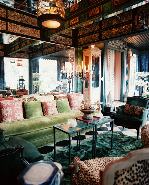 Tony Duquette - A green couch arranged with green and leopard-print upholstered chairs