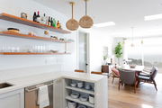 A view into the dining space from a contemporary kitchen.