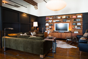 A deep sectional and DIY partitions in the den of Hammer and Spear's LA loft