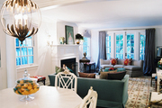 An open living-dining space with a mix of vintage furniture