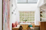 A bright dining space with wooden chairs.