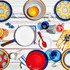 A variety of colored dishes decorate a brunch tablescape