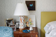 A bedside table vignette in a master bedroom