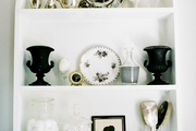 Built-in shelving holding black-and white decorations and bath accessories
