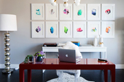 Colorful office area with gold light fixture and animal print area rug.