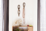 A vignette with distressed industrial hooks between two windows