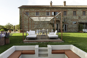 White seating areas against stone walls at La Bandita, in Tuscany