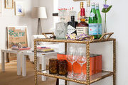 A three-tiered bar cart in an entryway