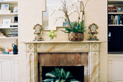 Brick flooring and a faux-marble mantel in a family room