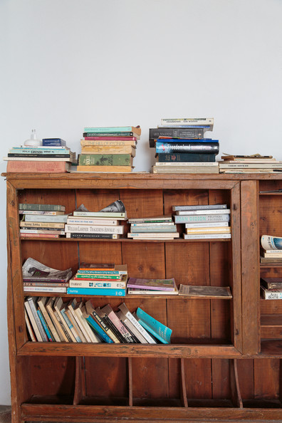 Vintage Furniture - Books stacked on wooden shelves
