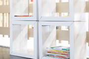 Four white cubbies for books.