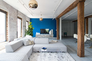 Blue accent wall in window-lit living area.