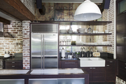 Open shelving and brick walls in a kitchen