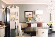 White tufted dining chairs surrounding a wooden table