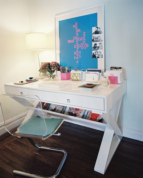 Work Space - An X-base white desk paired with a transparent chair