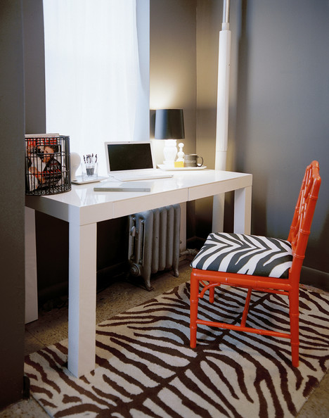 Work Space - A white Parsons desk paired with a red fretwork chair with zebra-print upholstery