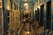 Striped upholstery, checkered flooring, and elegant archways in an Indian bar