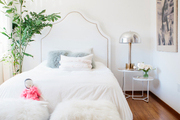 No princess decor here—this child's bedroom resonates easy bohemian vibes from the diamond-patterned rug to the art that was purchased. Headboard by Serena & Lily. Benches by Jonathan Adler.