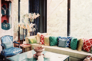 Colorful pillows and malachite patterns in a seating area