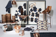 Home decor in a copper and navy color palette