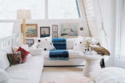 White couches in a laid-back sitting area