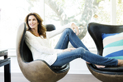 Cindy Crawford lounging in a sun-drenched living room in Malibu, California