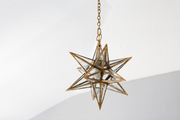 Star-shaped chandelier hanging from vaulted ceiling.