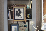 Decorative objects in open bookshelves in a home office