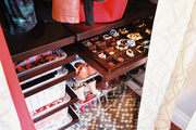 Trays for jewelry storage and wire baskets in an efficient closet space