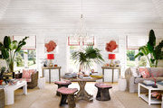 The great room of a Caribbean home with white walls and colorful furnishings