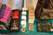 Candles, bags, throw blankets, and other gift-ready items at Thomas Sires