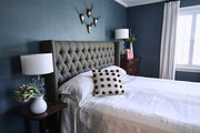 A traditional bedroom with blue walls.