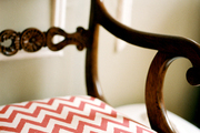 Red chevron fabric on a wooden chair
