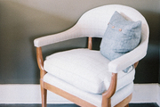 A vintage chair upholstered in light-gray plaid