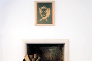 A negative-exposure artwork of Marilyn Monroe hung above a fireplace